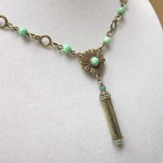 etched bullet casing necklace by storytales on Etsy, $34.00