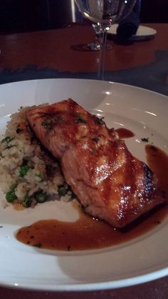 Wild Caught King Salmon pepper honey glaze, savory rice carrots and snow pea medley   #mancysbluewatergrille
