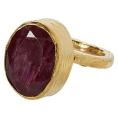 Ruby and Gold Ring. This 21ct gold plated ring is hand crafted with a stunning oval shaped faceted ruby, perfect with anything from evening wear to a relaxed bohemian look.