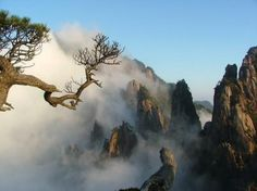 HUANGSHAN, China: formed in the Mesozoic, approximately 100 million years ago, when an ancient sea disappeared due to uplift. Later, in the Quaternary Period, the landscape was shaped by the influence of glaciers. The area is well known for its sunsets, peculiarly-shaped granite peaks, Huangshan Pine trees, hot springs, winter snow, & views of the clouds from above. Huangshan is a frequent subject of traditional Chinese paintings & literature.