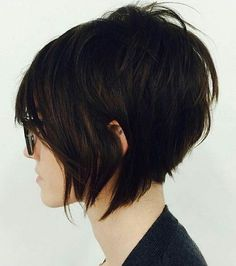 Artsy side swept bangs with a slight pinch of messy volume on top. Who says short hair isn't sexy?