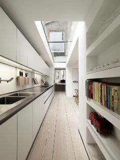 Like the galley kitchen in an shaped room with doors into garden From MacDonald Wright Architects, Parkholme Road House