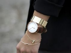 Layer your watch wrist with delicate and chunky pieces of gold arm candy