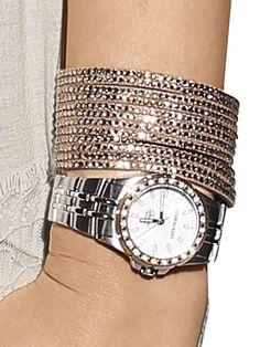 Armband mit Strass Steinchen und Druckknopf, in zwei Längen tragbar, Länge ca. 22 cm. Breite ca. 3,5 cm. Nickelfrei. Obermaterial: 90% Polyurethan, 5% Kunststoff, 5% Metall...