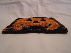 Ravelry: Pumpkin Illusion Face Dishcloth pattern by Cheryl Edwards