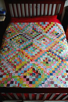 quilt top on bed by patchandi, via Flickr