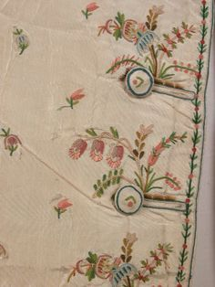 Detail embroidery, vest, 1790. Cream silk with multicoloured embroidery. Double breasted embroidered in chain stitched flower border and all-over sprig. Slit pockets worked with embroidered flowers.