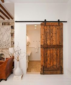 Barn Door. Basement utility room http://www.babyrabies.com/2012/09/diy-barn-door-track-tutorail/