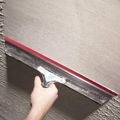 How to Skim Coat Walls - using a squeegee. I tried this in the hallway and it works great! Now to tackle the living room/dining room area.