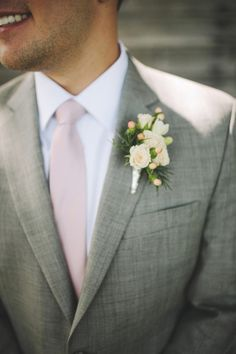 Blush tie, gray suit