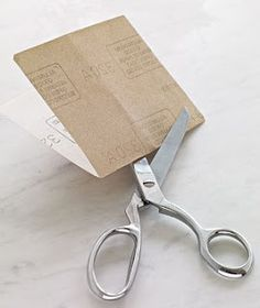 sharpen scissors by cutting tinfoil or fine sand paper