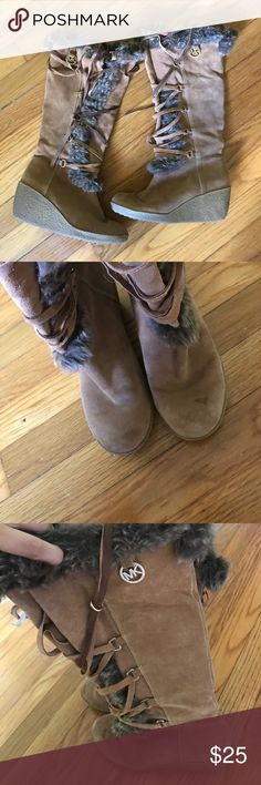 Michael KORS Leather Fur Boots Boots with the Fur!!!! 😂 these boots are super cute - in well loved Condition. Price reflects. Still plenty of use left. Laces fraying and a few rain spots but are good condition still. Priced to sell. KORS Michael Kors Shoes Winter & Rain Boots