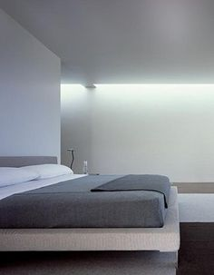 Bedroom inside the Taghkanic House by Thomas Phifer and Partners. Beautiful indirect lighting.