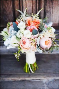 Feathery soft peach peonies