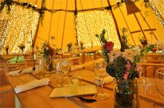 It was blowing a real gale outside.....serenely beautiful inside the tipis
