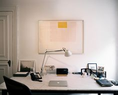 Minimalist Modern Work Space    A marble desk in a neutral office space  Details: Silver Midcentury Lighting, Gray Minimalist-Modern Work Space  Keywords: Home Office, November December 2011 Issue, Desk Lamp, Susan Becher, Computerdesk, Desk