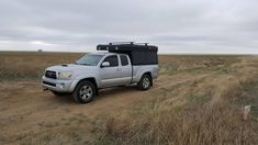 The hottest trend in the car-camping and overland world right now is the lightweight pop-top truck camper. It combines a truck topper shell and a rooftop tent. These go-anywhere truck campers are ready for adventure! Pop Up Truck Campers, Pickup Camper, Truck Bed Camping, Truck Tent, Slide In Camper, Off Road Camper, Top Tents, Roof Top Tent, Truck Toppers