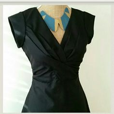 """Urban Outfitters Black Fit and Flare Cap Slv Dress 100% Wool. Gorgeous vintage look. Me and You brand from UbNo. Still has tags.  Elegant feel for a night out on a date, dinner party or any occasion!  Size XS.  Has small hole in the back..see photo.   Fabric has two layers so the hole doesn't show skin...only black underneath. Also has a hole at the bottom of zipper, can be sewn. Measurements laying flat:  chest: 16""""pit to pit.  Waist:  13""""across.  Length: 36 """" Urban Outfitters Dresses"""