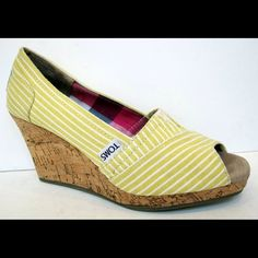 """TOMS Yellow Pinstripe Fabric Cork Wedge Canvas TOMS shoe features pretty peep toe and espadrille-style midsole. 3-1/4"""" tonal cork wedge heel is naturally lightweight and springy.    These are in really great, clean condition. There is a slight nick on the back of one heel. TOMS Shoes Wedges"""
