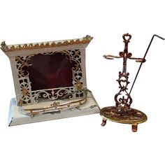 Here we have two classic pieces for Dollhouses. The first item is a classic fire place made of tin plate, in a very nice condition, with the original