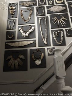 What a cool idea to recreate on craft fair booth walls. Black background really shows off the jewelry
