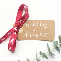 Christmas gift tags by M.B. Calligraphy can be found on etsy in mbcalligraphyshop