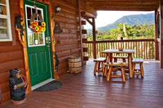 Fireside Dreams - Wouldn't you love to sit and eat at this table? The view is perfect! We couldn't think of a more peaceful place to dine! This 2 bedroom cozy log cabin has a hot tub, rocking chairs, pool table and much more! #petfriendly
