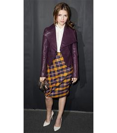 Anna Kendrick spotted at the Vivienne Westwood S/S 14 show in London in a Vivienne Westwood Short Purple Tartan Skirt center stage with a crisp white button up and muted Leather Jacket from the designer's Anglomania collection.