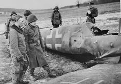 22 January 1945.  A German pilot and the US troops of the 90th Infantry Division that shot him down near Halstoff, France, survey his Bf 109G.