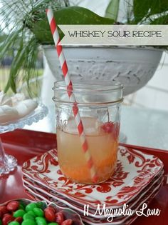 Hosting a New Year's Eve party?  These from-scratch whiskey sours are so yummy and easy; your guests will love them.  For four servings, combine 3/4 c. whisky, 1/2 c. fresh lemon juice, 1/2 c. fresh lime juice, and 2/3 c. simple syrup.  Serve garnished with maraschino cherries and orange slices in mason jars, with paper straws and cocktail napkins from HomeGoods.  Don't forget the colorful appetizer plates for the nibbles.  Happy New Year…