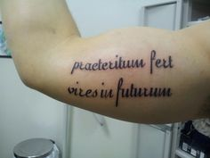 "My husbands tattoo. Latin for ""the past brings strength to the future"""