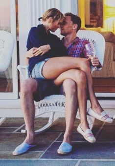Love's young dream: Taylor Swift and Tom Hiddleston posed together during her Fourth of July celebration. They wore his and hers espadrilles, held hands and rubbed noses