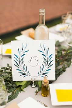 table number - photo by Julia Elizabeth Photography http://ruffledblog.com/italian-inspired-backyard-wedding
