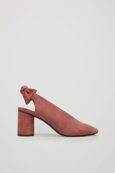 These pump style slingback sandals are made from softly brushed suede with a tonal, rounded heel. A simple, sleek design with a chunky, removable bow at the back, they are completed with cushioned insoles.