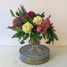 Pretty bouquet in pink and green with berries, tulips, sedum and roses in a cut glass vase, by Gardenia Organic