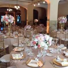 Hate the flowers but I love the use of the high-low centerpieces