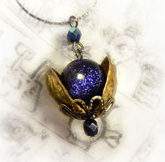 universe in a nutshell necklace (blue goldstone, pistachio/other shells)