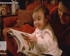 Baby thinks she can eat food from the magazine