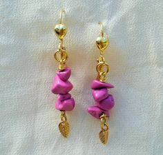 These lovely gold plated earrings have dyed turquoise stones with gold leaf charms.