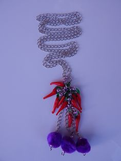 Long silver nacklace made of red glass #pepper charms and purple thread #fringes. www.ayaglass.hu