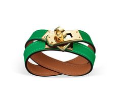"Kelly Double Tour Hermes leather bracelet (size S) Bamboo swift calfskin  Gold plated hardware, 2.25"" diameter, 14.5""long, 0.5""wide, <6.7"" circumference."