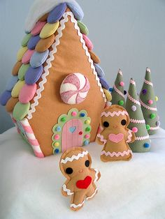 So cute! felt gingerbread house, men and trees. use velcrow on the candy pieces and let kids decorate again and again.