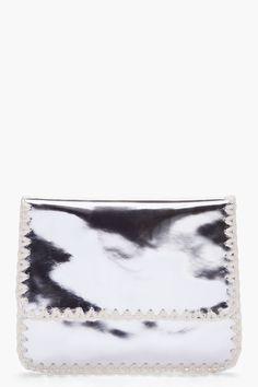 Metallic clutch with crocheted edges... #metallic #clutch #crochet