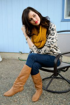 Mustard-coloured scarf brings this look together.