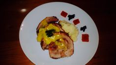 Rolled pork belly with mash potatoes, chili gels and balsamic caviar. Topped with home made sweet mustard.