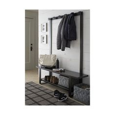 Shop Welkom Hall Tree Coat Rack.  Representing a new generation of outerwear storage, our contemporary coat rack is crafted entirely of iron with a durable gunmetal powdercoat finish in rich, dark bronze.