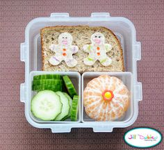 Bento Box:    Here's another gingerbread bento but this one was for her afternoon nutrition break. She had half a chicken sandwich with 2 little gingerbread men cut out of whole wheat tortilla on top. I decorated with little men with my food safe markers. She also had a container of sliced cucumbers and a peeled clementine orange with a pick on top.