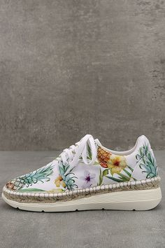 """Slip into the Free People Jackson White Tropical Print Espadrille Sneakers and instantly be transported to the tropics! Palm leaves, pineapple, and flower print canvas upper with white laces top a espadrille-wrapped and rubber 1.5"""" sole. Available in Euro sizes 36-41."""