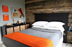 tween boys room.....I like the orange with the grey. Oh, and look there's that wood wall :)