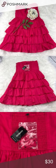"SALEExpress Hot Pink Strapless Ruffled Dress Vibrant NWT Express Hot Pink Strapless Ruffled Dress 26"" from the top of the shoulder to the bottom 15"" from armpit to armpit Gorgeous Dress Express Dresses"